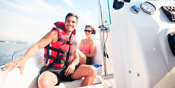 Young,Couple,On,Boat