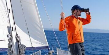 Man,Sailing,With,Sails,Out,On,A,Sunny,Day